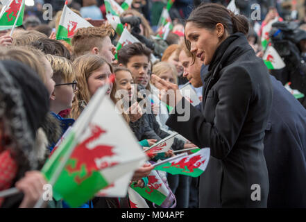 Prince Harry and Meghan Markle meet members of the public during a walkabout as they visit Cardiff Castle. - Stock Photo