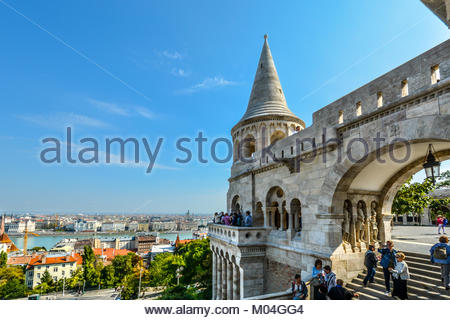 Tourists enjoy the fairy tale towers at Fisherman's Bastion overlooking the Danube River at Budapest Hungary's Castle - Stock Photo