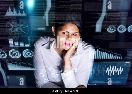 young businesswoman looking at futuristic graphical user interface. Internet of Things. Smart City. - Stock Photo