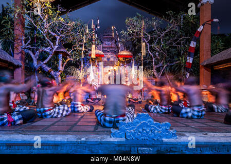 Bali, Indonesia - October 2015: Dancers praying in between Traditional Kecak fire Dance performance in temple at - Stock Photo