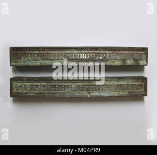 Bronze furniture attachments with silver inlay MET SF1723031abedited - Stock Photo