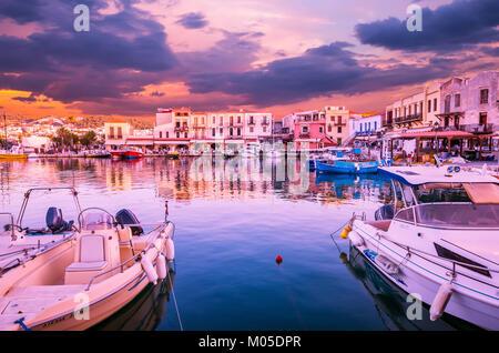 Stunning sunset over the old venetian port of Rethimnon on Crete island, Greece. - Stock Photo