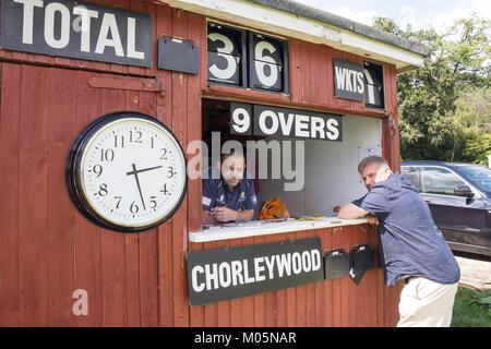 Scoring shed at Saturday match at Chorleywood Cricket Club, Chorleywood, Hertfordshire, England, United Kingdom - Stock Photo