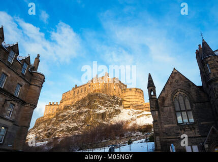 View of Edinburgh Castle from the Grassmarket after snowfall during winter in  Scotland, United Kingdom - Stock Photo