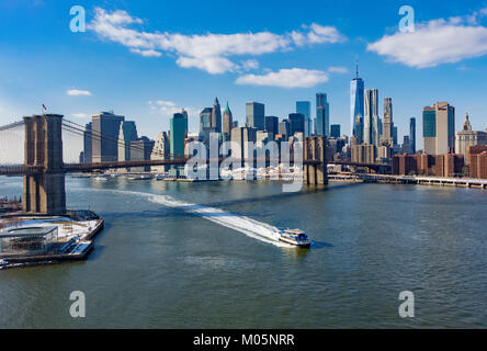 The Brooklyn Bridge and Lower Manhattan skyline seen from across the East River in winter - Stock Photo