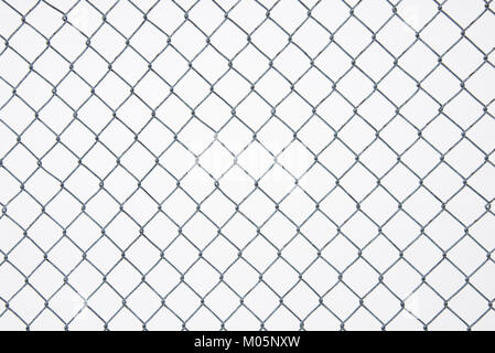 Chain link fence with a background of snow on a playground in Speculator, NY USA - Stock Photo