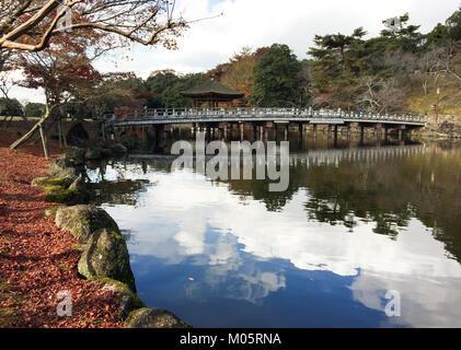 Stone bridge with the lake at autumn in Nara, Japan. - Stock Photo