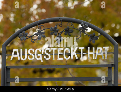 Head of a 'Ausgsteckt' board, where all the open taverns selling homegrown wine are listed - Stock Photo