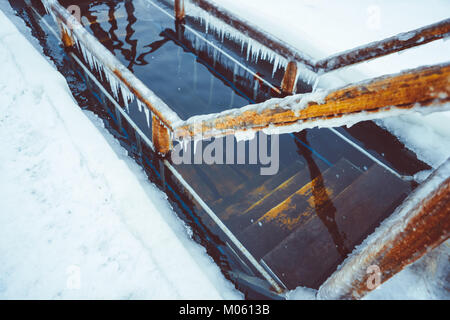The snow on the railing of the baptismal font in Russia - Stock Photo