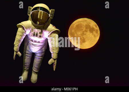 Tim Peakes Soyuz Russian mockup spacesuit with moon background Shildon Railway Museum - Stock Photo