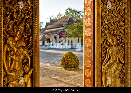 View to Wat Xieng Thong Temple in buddhism and UNESCO World Heritage Town Luang Prabang, Laos - Stock Photo