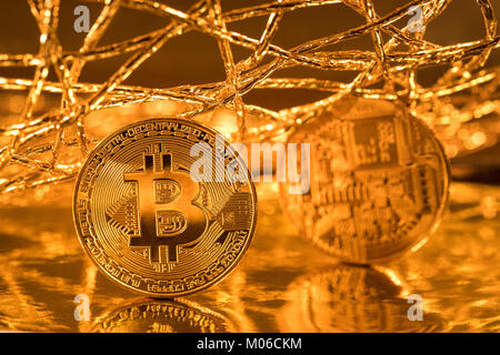 View of golden coins of Bitcoin cryptocurrency in the global network - Stock Photo
