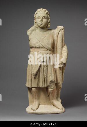 Limestone statuette of Dionysos holding a thyrsos MET DP205288 - Stock Photo