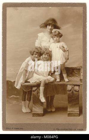 Early 1900s studio portrati photograph beautiful mother and pretty daughters, wearing summer dresses, Buenos Aires, - Stock Photo