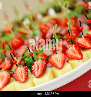Appetizers, gourmet food - canape with cheese and strawberries, catering service - Stock Photo