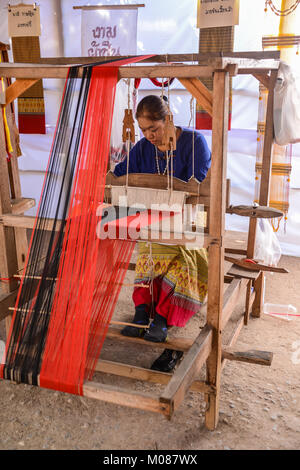 CHIANGMAI, THAILAND - JANUARY 24, 2015: Indigenous woman is demonstrating weaving fabric  in 22nd Traditional Skirt - Stock Photo