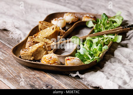 Asian style fried scallops - Stock Photo