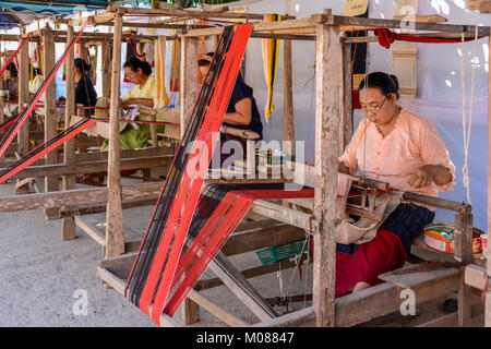 CHIANGMAI, THAILAND - JANUARY 24, 2015: Indigenous women are demonstrating weaving fabric in 22nd Traditional Skirt - Stock Photo