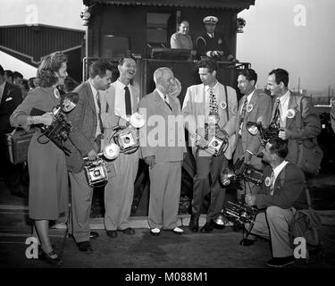 Former President Harry S. Truman by a train with 7 photographers, Photo Press Club, Los Angles, November 30, 1960. - Stock Photo