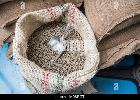 Sacks of coffee beans at a coffee importer's warehouse. - Stock Photo