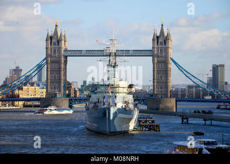 HMS Belfast and Tower Bridge, London. River Thames, UK. Space for copy - Stock Photo