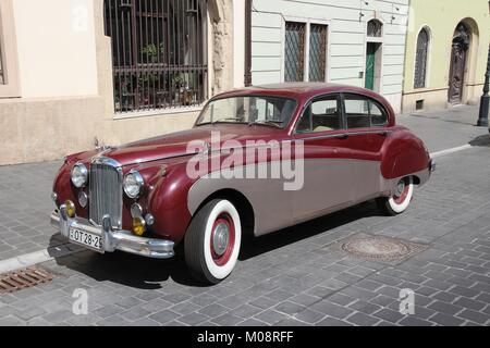 BUDAPEST, HUNGARY - JUNE 20, 2014: Classic Jaguar Mark IX parked in Budapest. It was produced in 1959-1961 as a - Stock Photo