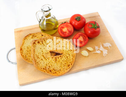 Italian food: friselle (dry bread), red tomato, oil and garlic. - Stock Photo