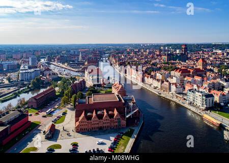 Gdansk, Poland. Aerial skyline with Motlawa river, bridges, marina, Baltic Philharmonic Hall and famous monuments - Stock Photo