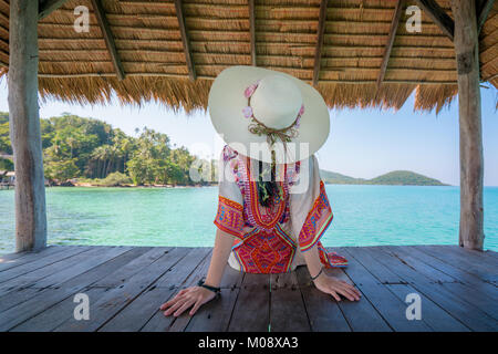 Beautiful Asian young woman relaxing in hut at tropical resort near the sea in Phuket, Thailand. Summer Vacation - Stock Photo
