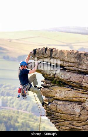 Rock climbing on Bamford Edge Peak District National Park, Derbyshire - Stock Photo