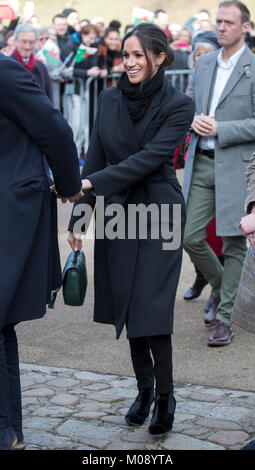 18th January 2018 Cardiff UK  Britain's Prince Harry and Meghan Markle meet the crowds waiting in the grounds of - Stock Photo