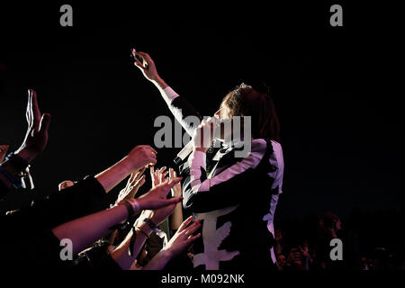 The Canadian indie rock band Arcade Fire performs a live concert at Hurricane Festival 2014. Here lead singer and - Stock Photo