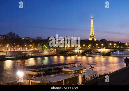 PARIS, FRANCE - APRIL 19, 2016: View over the river towards illuminated Eiffel Tower, Paris.The Eiffel Tower stands - Stock Photo