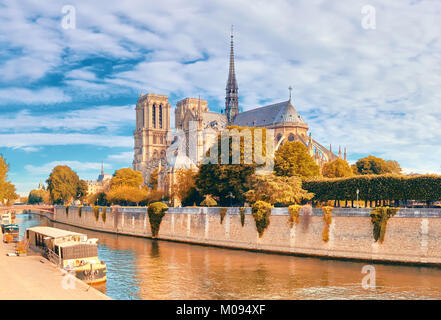 Notre Dame Cathedral in Paris on a bright day in Fall, panorama image - Stock Photo