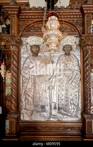 Church with images of saints, silver figures and silver chandeliers, Monastic Church Greek Orthodox two-nave church, - Stock Photo