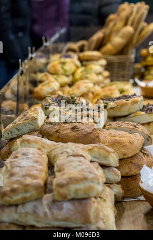 A variety of artisan bread on display on a market stall in Borough Market, London - Stock Photo