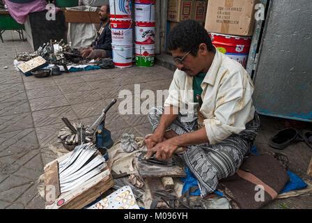 A man makes janbiyas on May 4, 2007 in Sanaa, Yemen. Janbiya is a traditional knife that yemeni men wear it as an - Stock Photo