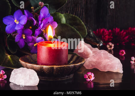 Red Candle with Rose Quartz Crystals - Stock Photo