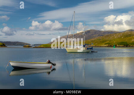 Boats Overlooking Scalpay Harbour - Stock Photo