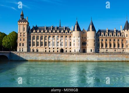 Conciergerie building in Paris, France, on the island Ile de la Cite. It is a former riverside fortress that was - Stock Photo