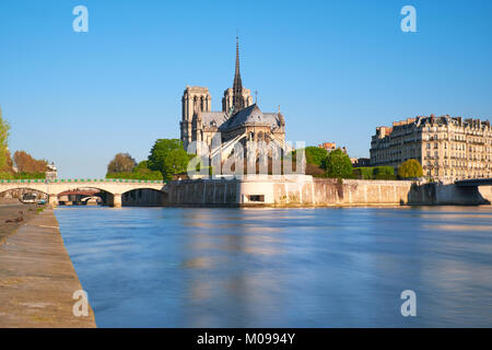 Paris, view over river Seine with Notre-Dame cathedral from the back on a bright day in Spring. - Stock Photo