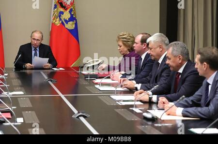 Novo-Ogaryovo, Russia. 19th Jan, 2018. Russian President Vladimir Putin chairs a meeting of the permanent members - Stock Photo