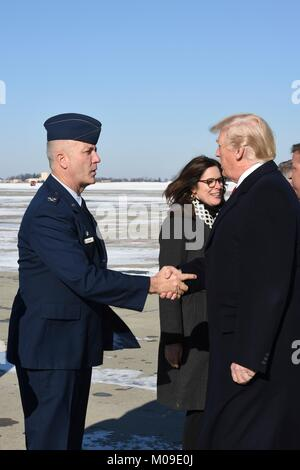 U.S. President Donald Trump is greeted by Col. Raymond Hyland, the Maintenance Group Commander on arrival at the - Stock Photo