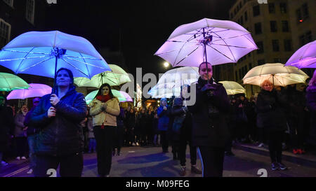 London, UK. 19th Jan, 2018. 'The Umbrella Project' by Cirque Bijou (UK) performs in Piccadilly. Lumiere London, - Stock Photo