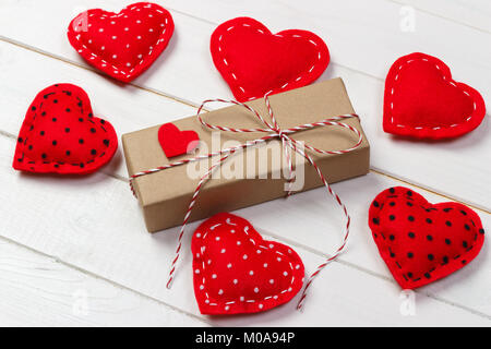 Valentine day background with gift box and hearts. - Stock Photo