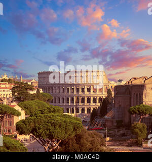 Construction work by Colosseum in Rome, Italy, on a sunset, panoramic image. - Stock Photo