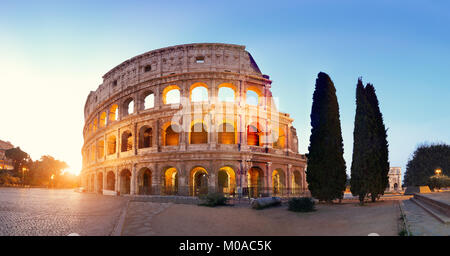 Panoramic image of Colosseum (Coliseum) in Rome, Italy, at sunrise,