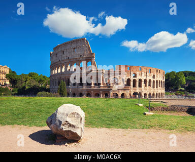 Rome, Italy. View of Colosseum from the Palatine Hill on a sunny day with blue sky and clouds. - Stock Photo