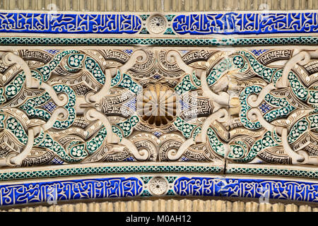 The Alcazar of Seville, Spain. The inside of a arched doorway. The top of it seen from below. Frog's eye view. - Stock Photo
