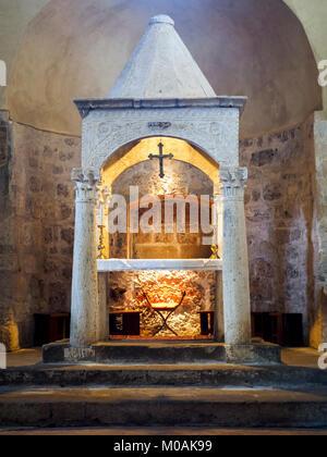 Altar in the Romanesque church of Santa Maria Annunziata - Sovana, Italy - Stock Photo